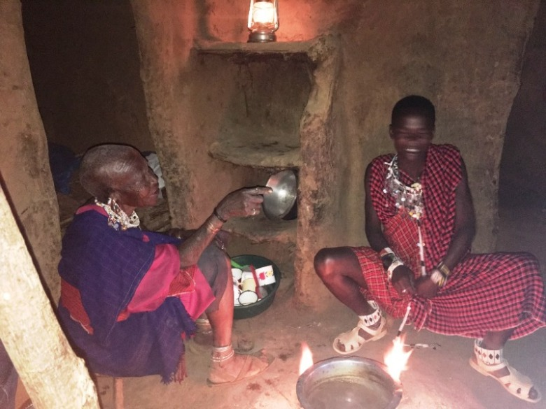 16 Maasai Bibi customarily hosts visitors to local tea prepared in her hut