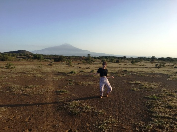 20 Julia enjoys herself at the bush walk with Mount Kenya behind