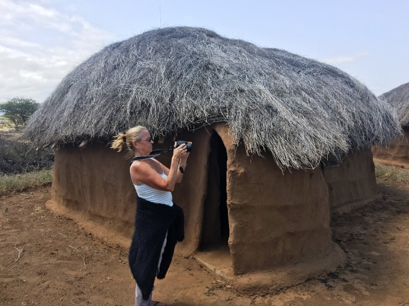 7 Leslie posing in front of her hut