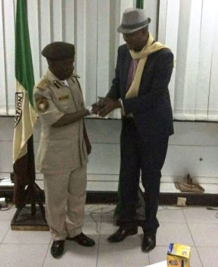 Ikechi and Nigeria Immigration Official